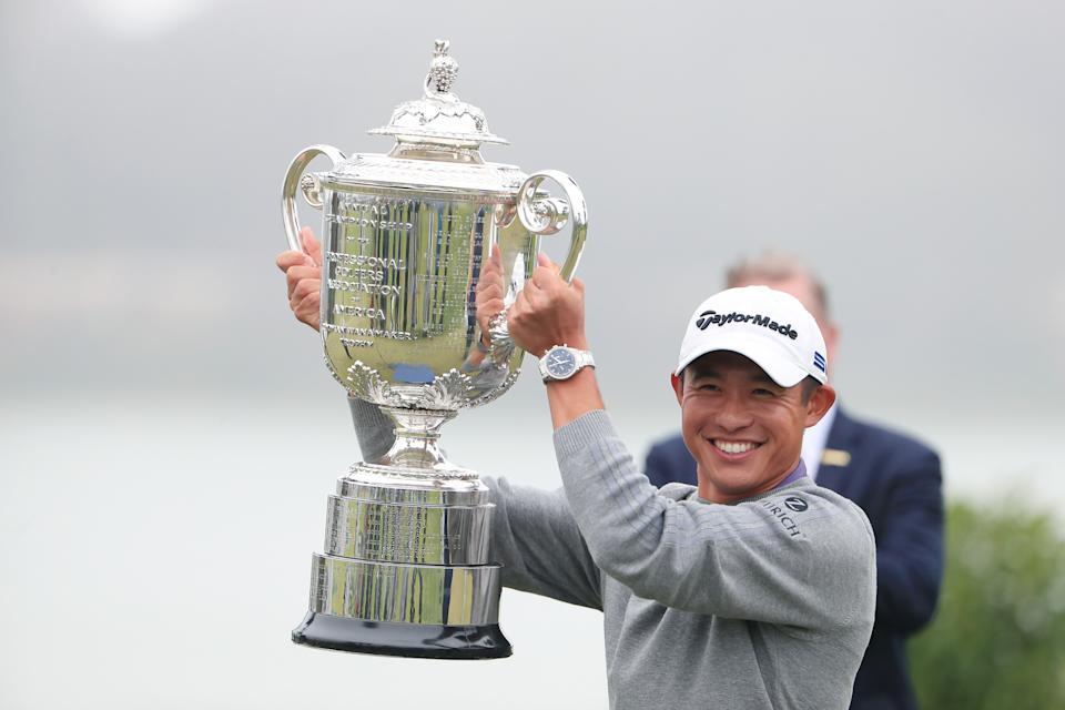 Collin Morikawa holding his trophy at the 2020 PGA Championship